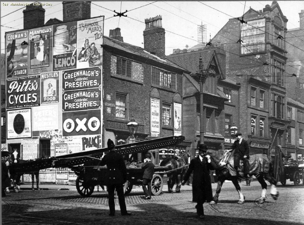 Portland Street, 1904. Great Eastern Railway signs visible on number 82. Image care of Manchester Libraries. Ref. m0485