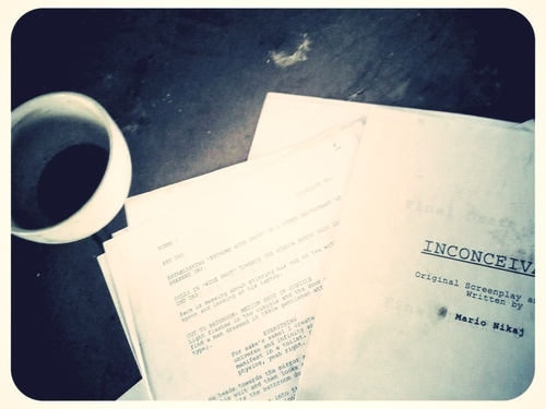 A script lying on the floor in the venue, with a very old coffee keeping it company.