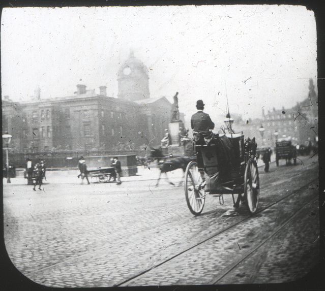 The original Lewis's in the background with 'spire'. Manchester infirmary in the foreground (now Piccadilly Gardens) Circa 1890s.