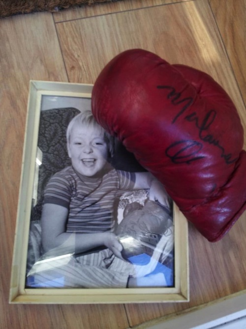 A reader contacted me to say he met Ali during his visit and had a boxing glove signed. This is John's photo of the glove and a photo of him looking very happy with himself at the time.