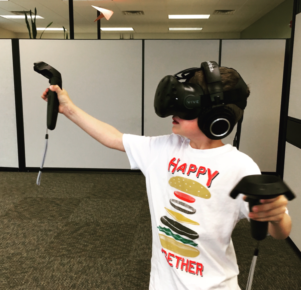 Kid Playing the Vive VR.png