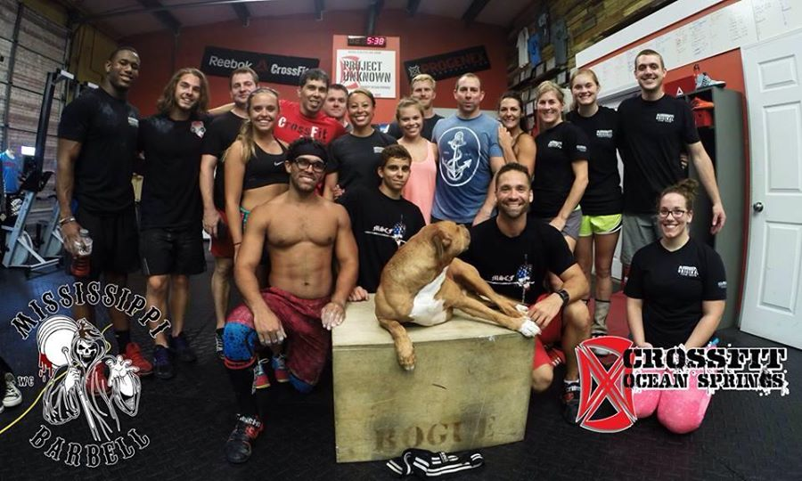 CrossFit Ocean Springs attendees with Coach Smith (far right) and Coach Sheppard (bottom right). Junior lifters Vic Sanders (far left) & Caleb Gressett (second to left) helped coach and demonstrate at this event. Photo credit: Tyler Smith
