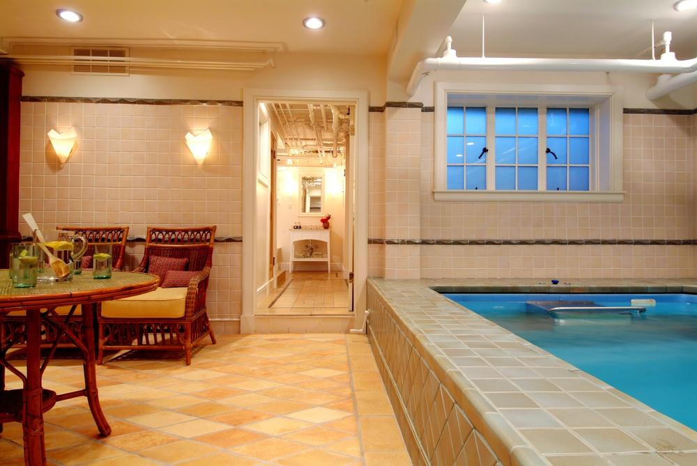 Indoor pool warner cunningham inc for Endless pool in basement