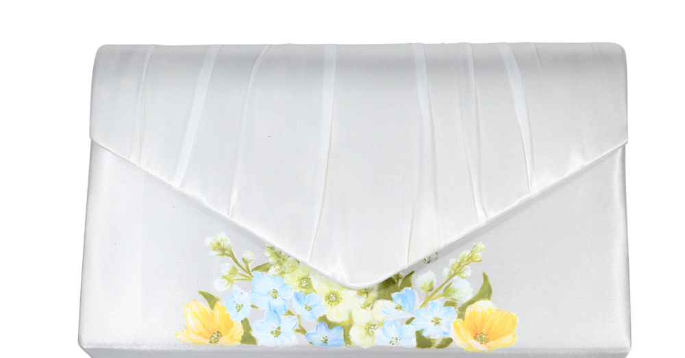 Matching wildflower print envelope clutch bag in ivory satin, perfect bridesmaid accessory.