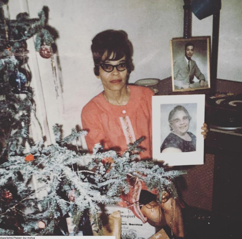 Nana (Grandmother) Holding image of Great Grandmother, Baltimore