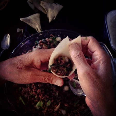 Photograph of my mom Dilshad folding a samosa, taken in August 2015 in Vancouver, British Columbia.