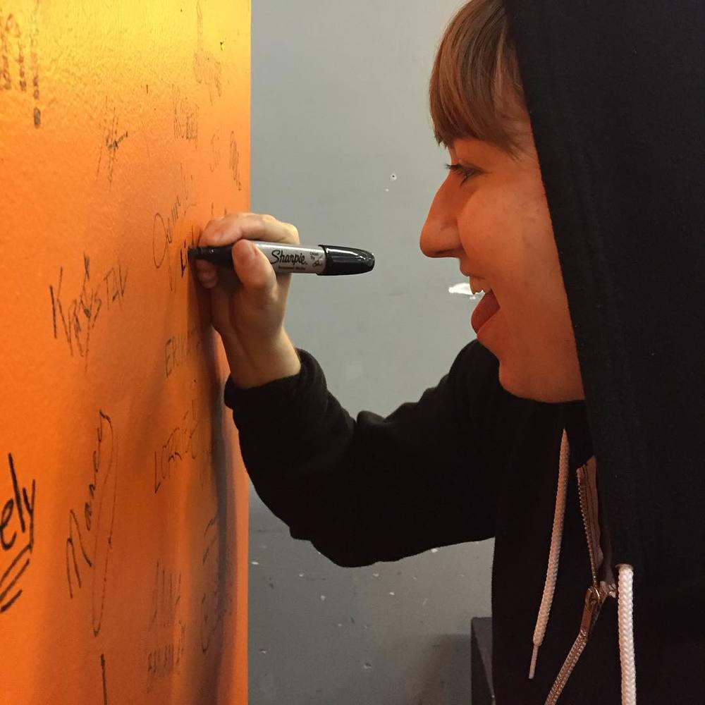 Signing the Hundo wall after hitting  100 workouts in 2015