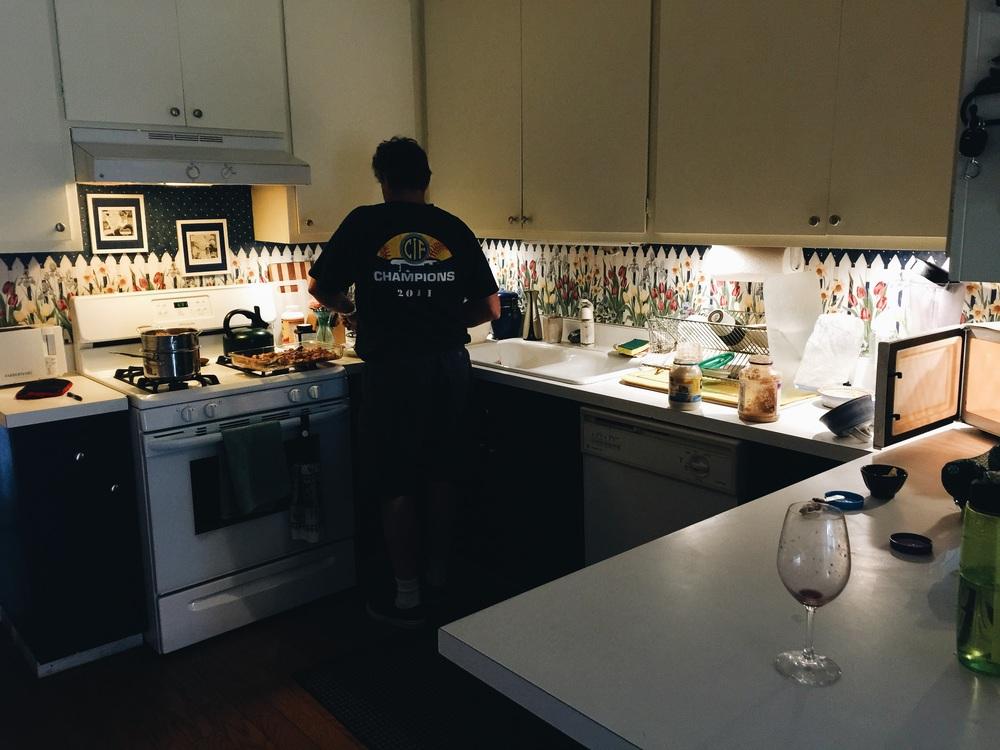 Tom making dinner