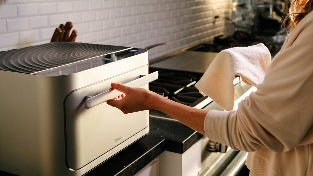 Brava | The world's fastest oven  A pure light smart oven, the first of its kind, with sensory inputs that monitor and adjust what's cooking in real time. Brava hits 500F in under a second. Make home your favourite place to eat.   Brava Website