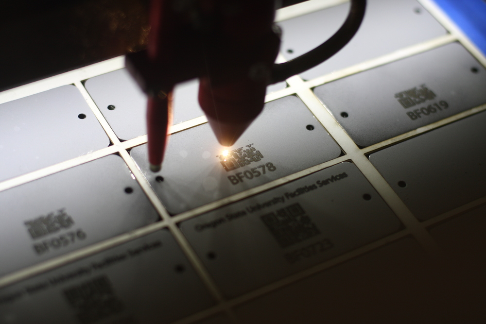 Laser etching QR codes onto stainless steel for Oregon State University