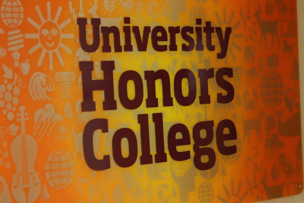 Hand spray painted sunburst, stenciled iconography, vinyl lettering for University Honors College.