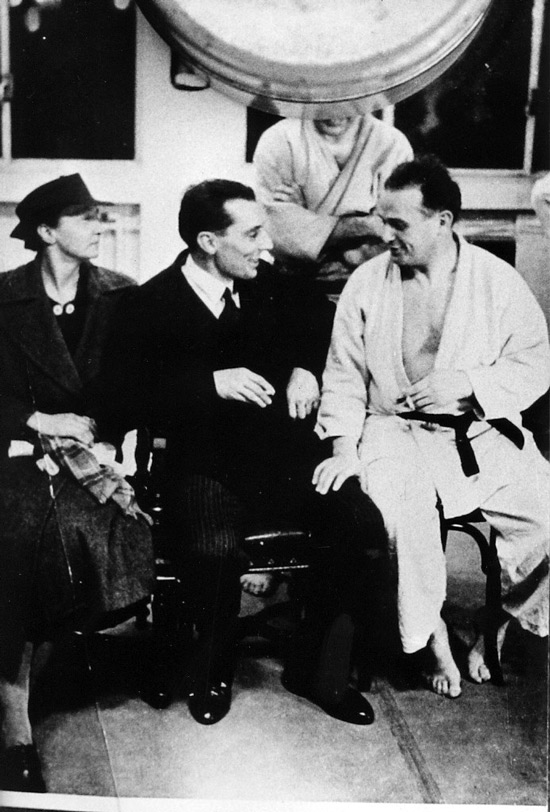 Feldenkrais with Marie Curie and Frédéric Joliot Curie in Paris in the 1930s. Feldenkrais's deep backgrounds in science and the martial arts both influenced his method.