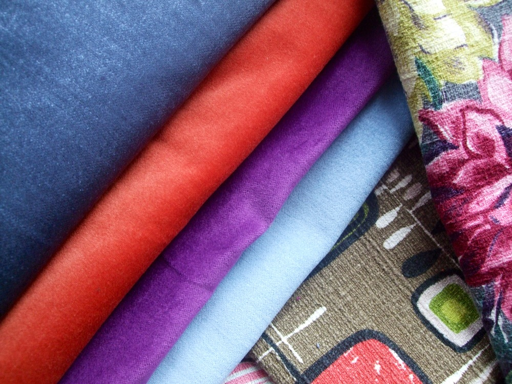 Examples of the colorful cotton velveteen fabric used for the backings of my pillows. Each pillow has velveteen piping to match the backing, and a zipper for access to easy cleaning.