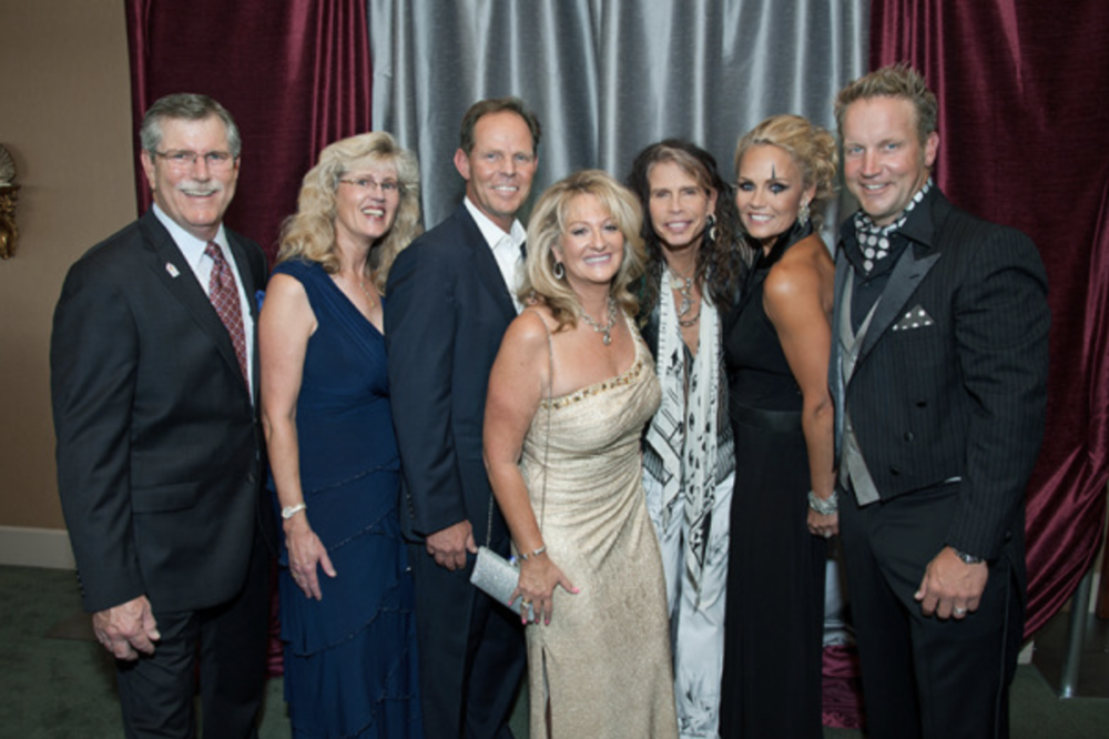 Chuck and Paula Day, Steve and Donna Evans, Steven Tyler, and Jennifer and Robert Gramins.png