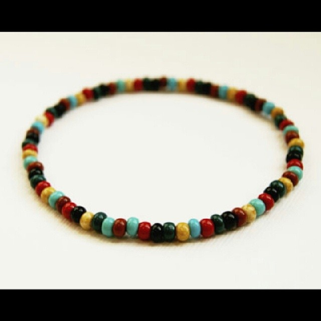 Handcrafted men's bracelet featuring multi colored Czech glass beads. Available at  www.nyamanid.etsy.com