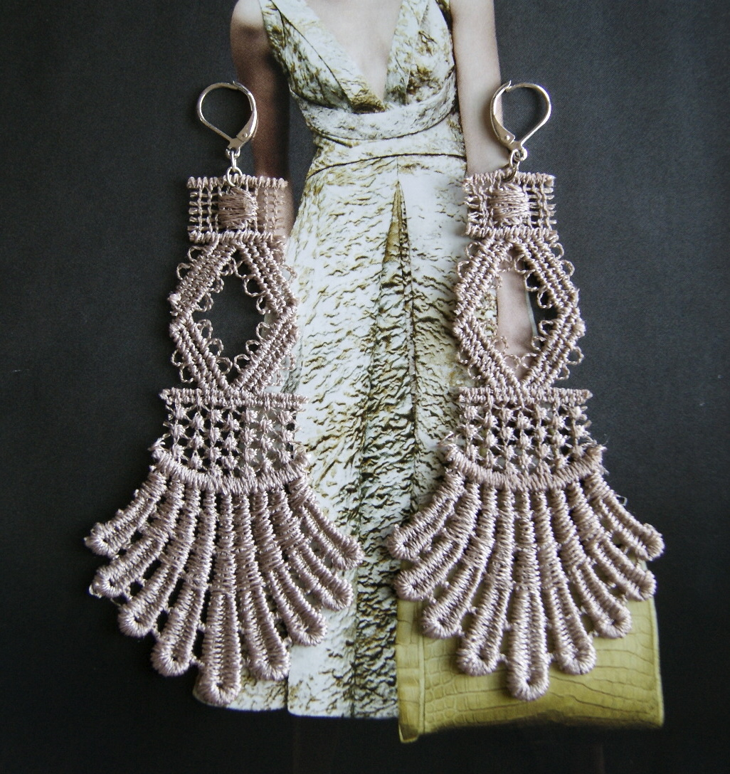 Soft shiny tone beige embraces these unique lace earrings. Fan like detail is held together by netted beads and a woven looped diamond. This piece was created using high quality lace, strategically cut, shaped and stiffened to hold its shape and finished with a silver lever back ear hook.