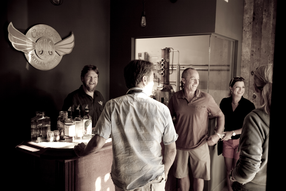 Ian Cutler, left, opened Cutler's Artisan Spirits in Santa Barbara's trendy Funk Zone development last year, He's produced white spirits like gin as his bourbon ages. His un-aged white whiskey will be on the market next month. Photo courtesy Cutler's Artisan Spirits.
