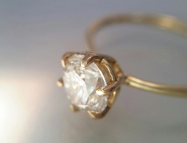Love the lighting in this photo� Custom engagement ring up close�And a video of that GORGEOUS Diamond before it was set💎 Canadian mined. Excellent cut. 1.31 carats of ethical perfection.��💎�💎🎆 . Sorting through photos as I recover from the flu (flu season this year is no joke!) and realized I hadn't posted pics of this beauty!! . . . #LivandLov #diamonds #canadiandiamond #FairminedGold #customengagementring #18kGold #shesaidyes  #diamondsareagirlsbestfriend