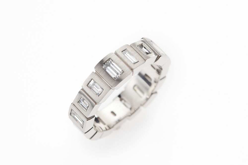 LUCIR: Diamond Baguette Eternity Ring in Platinum.