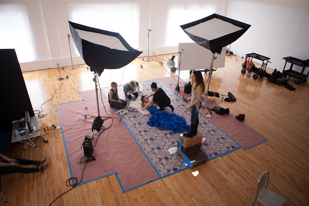 An overhead shot of the set, the team, and the lighting schematic (two softbox lights, one grided and diffused key light).  Oh, and of my client's lovely jeans and shoes!  ;-)