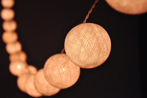 Cotton Ball String Lights from DLightOfficial on etsy.com - for a very sweet look, drape these across the ceiling indoors or outdoors.