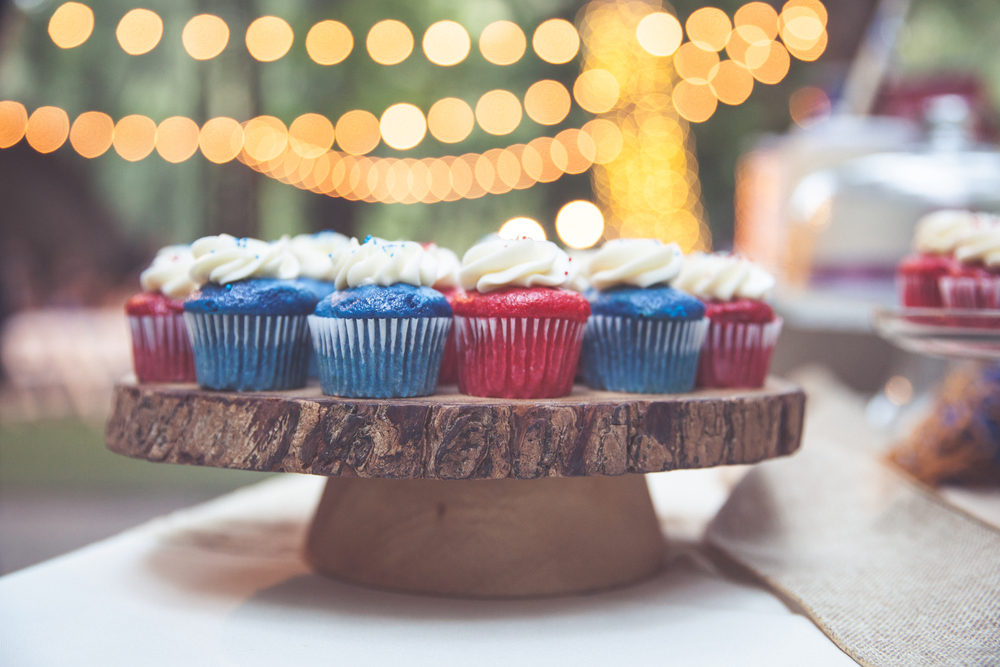 Vintage Market Lights draped between trees in this outdoor camp style wedding created beautiful backgrounds for everything. Just when you thought dessert couldn't look any sweeter.