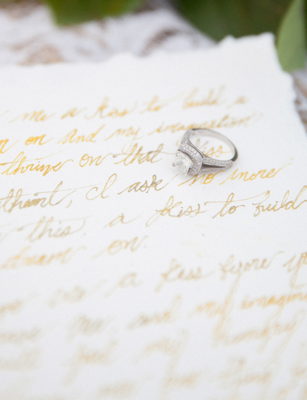 engagement ring on modern calligraphy