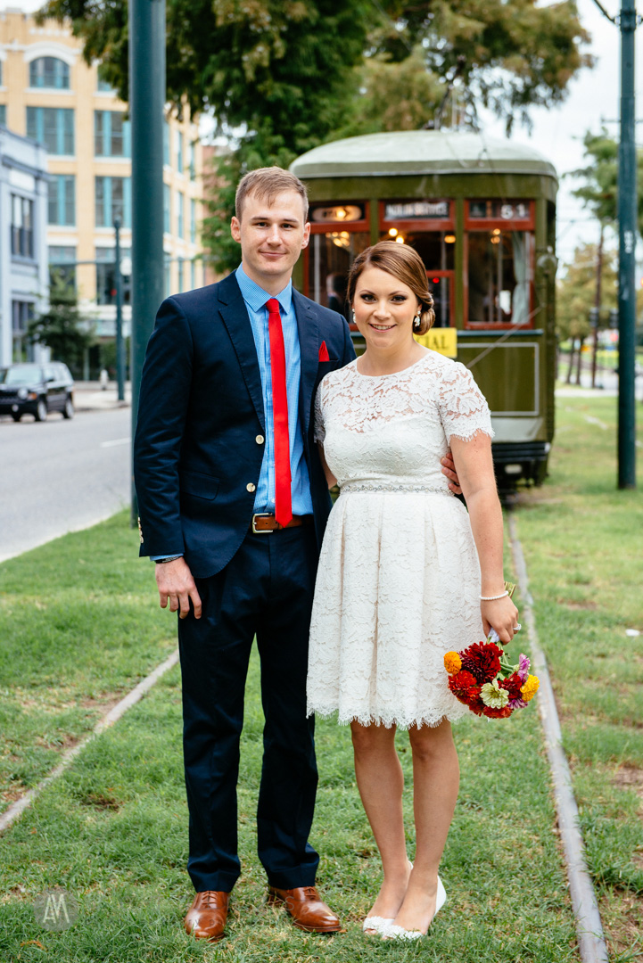 Wedding portrait in front of the streetcar in New Orleans.