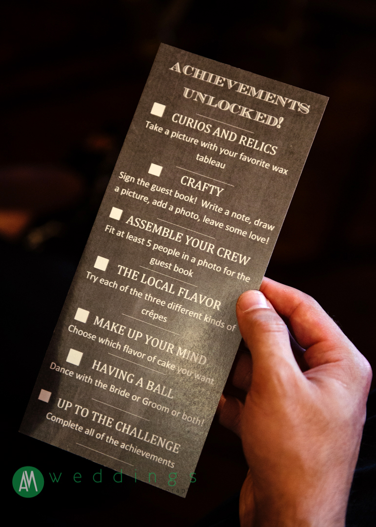 The wedding program featured a video game-inspired checklist on the back. Wedding reception at the New Orleans Wax Museum.