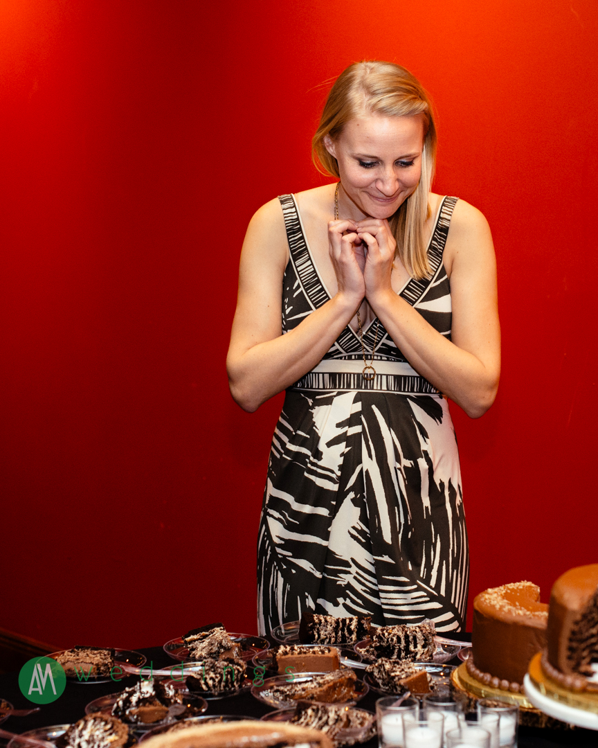 A guest is beside herself with delight at her three cake choices during the wedding reception at the New Orleans Wax Museum.
