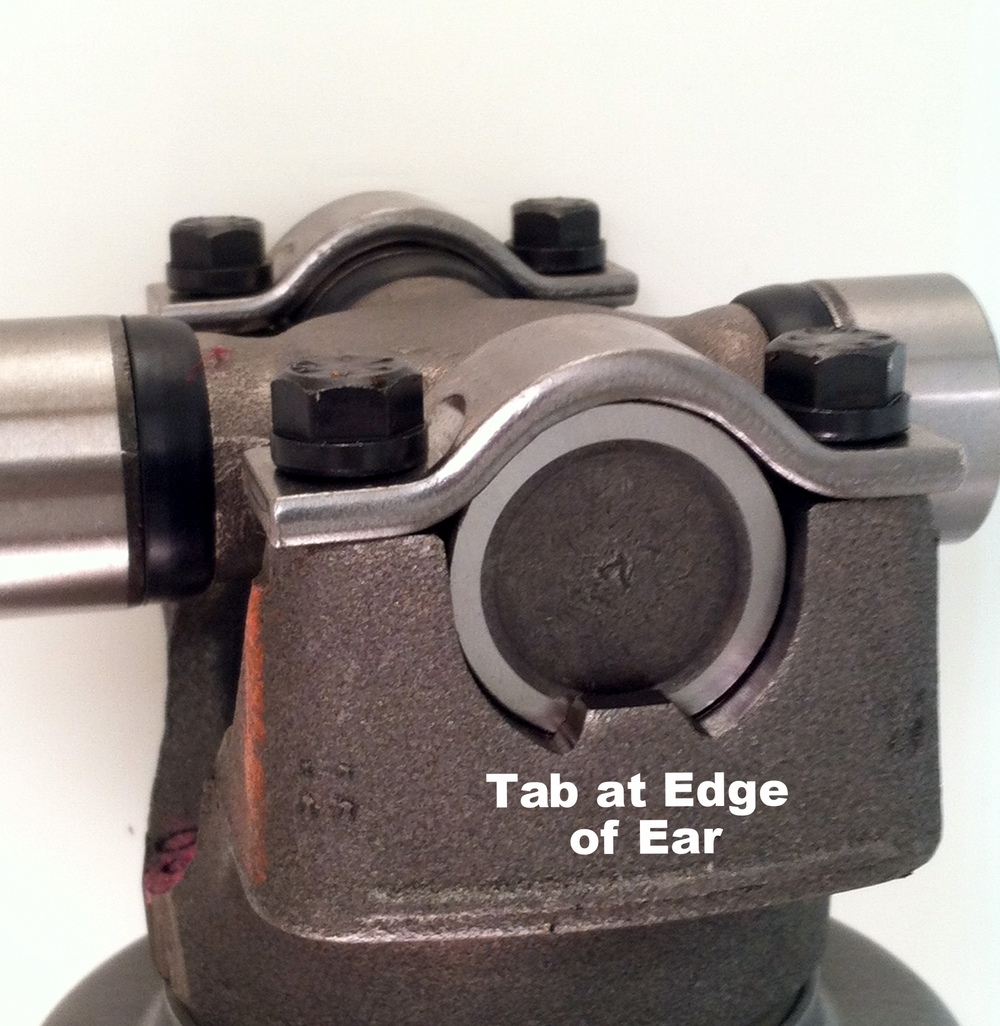 Pinion yoke with tabs (Outside Snap Rings)
