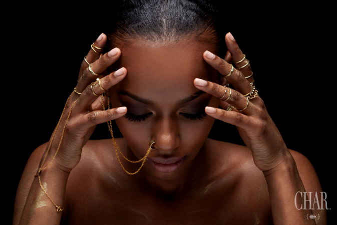 Piled on tribal rings & Xerxes chains.