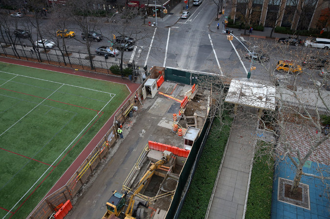 A dump runs through it.  the truck access ramp will bisect asphalt green leaving a soccer field on one side and a toddlers playground on the other