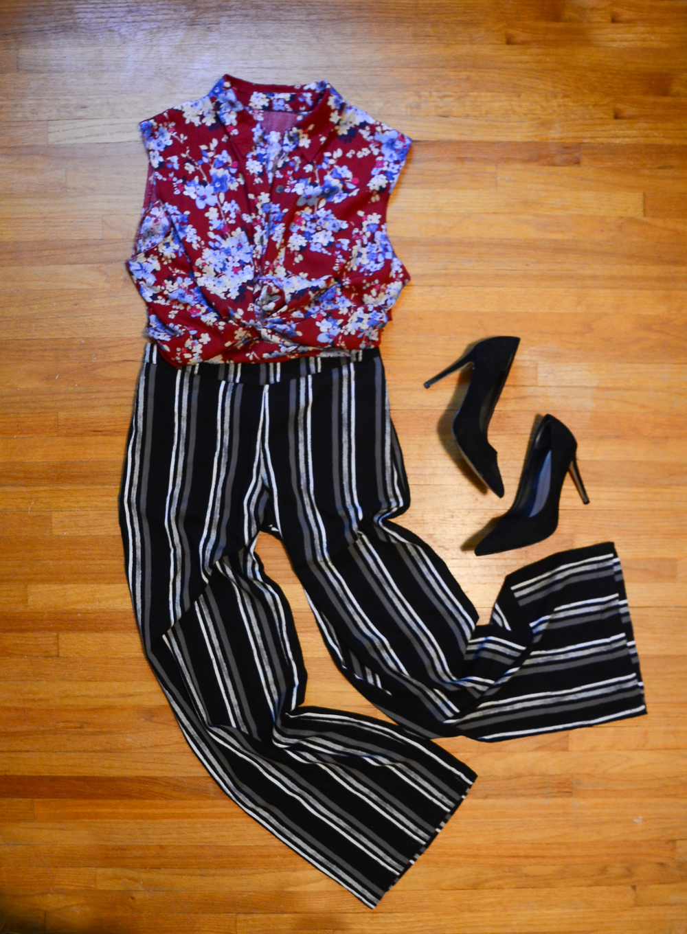 A more work-appropriate look. Wide-leg striped pants with a floral top.