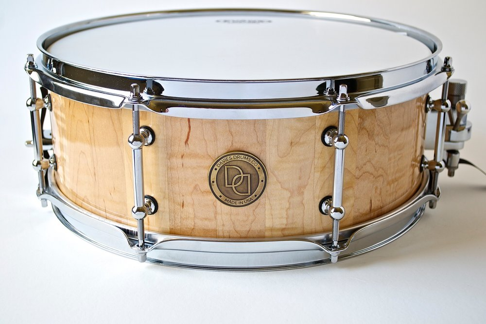 """Pictured: 5.5"""" X 14"""" Curly Maple Stave Snare Drum"""