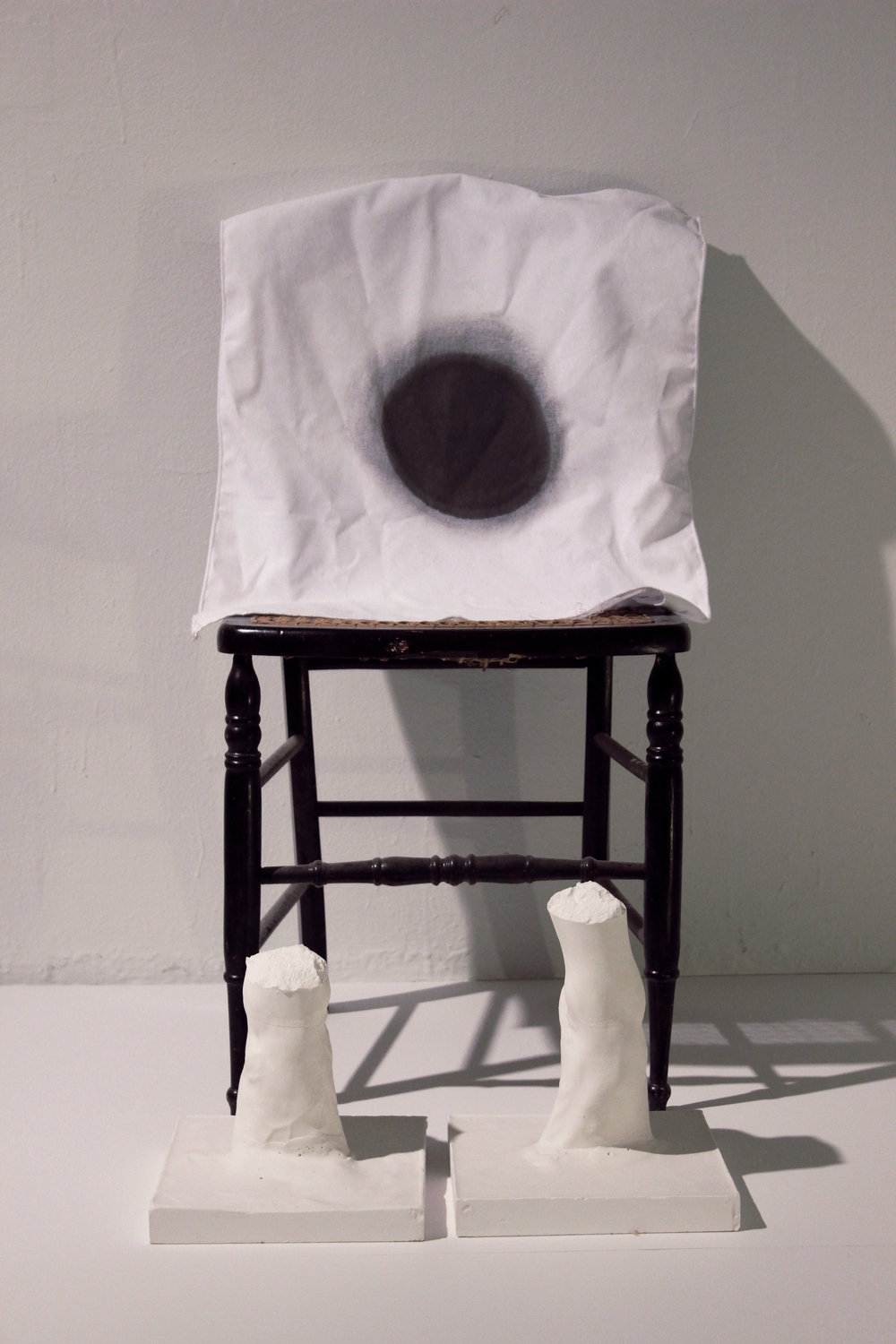 Plaster, Pillow Case, India Ink, Found Object. Dimensions Variable. 2013.