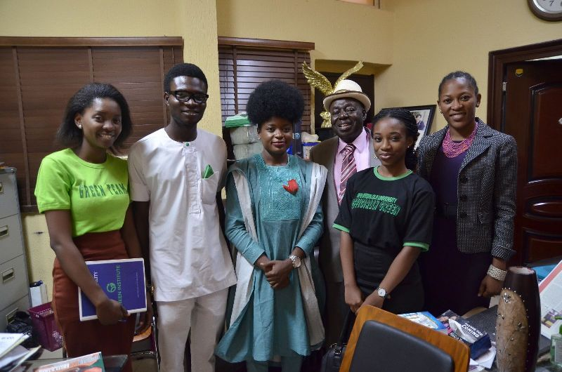 THE FOUNDER OF AFE BABALOLA UNIVERSITY WITH GREEN MEMBERS