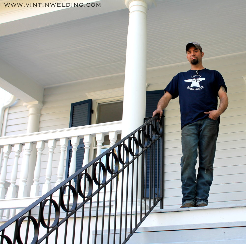Making our mark in WV. One home at a time. - Here, Danny Trenary is pictured alongside a custom railing he made to replicate the style of the gate at the home in the Harpers Ferry Historic District. The gate was from the civil war era.