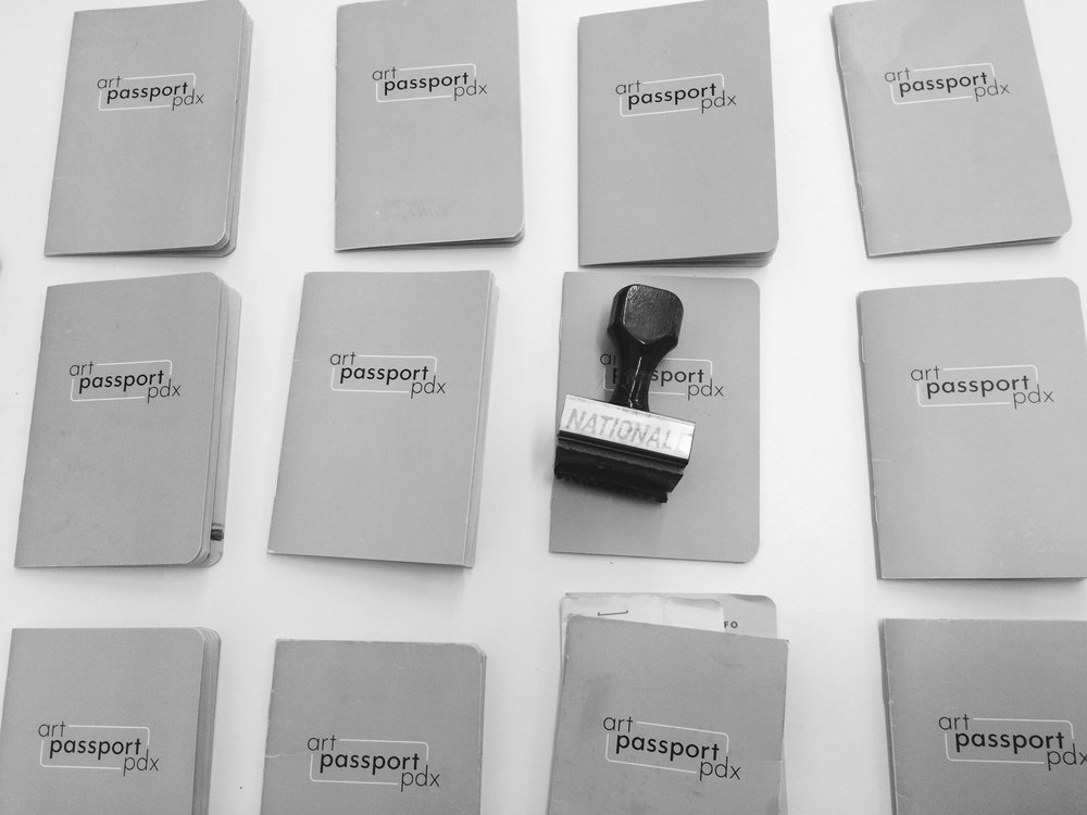 well-loved passports ready to be submitted for a chance to win $1600 to spend on ART!
