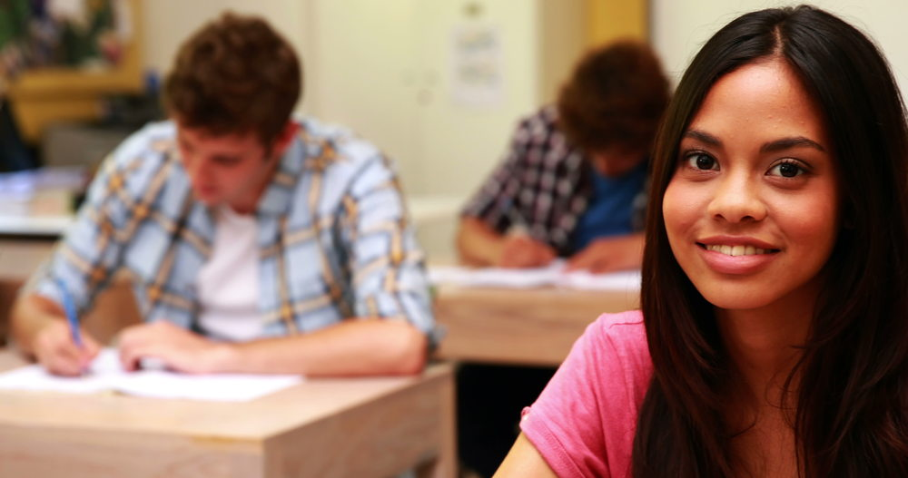 stock-footage-student-smiling-to-camera-in-classroom-at-the-university.jpg