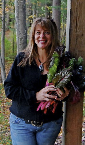 Lynn after gathering a bunch of Swiss chard from her garden.
