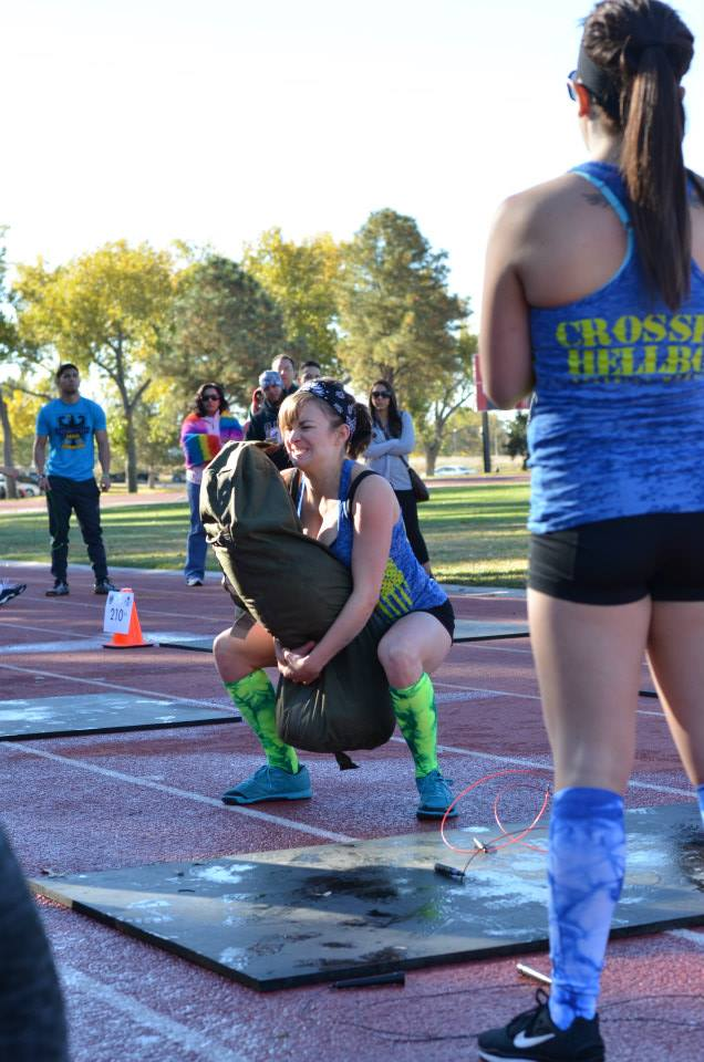 6 months after the birth of my son I participated in a local crossfit competition.  This is me squatting a 100lb sandbag