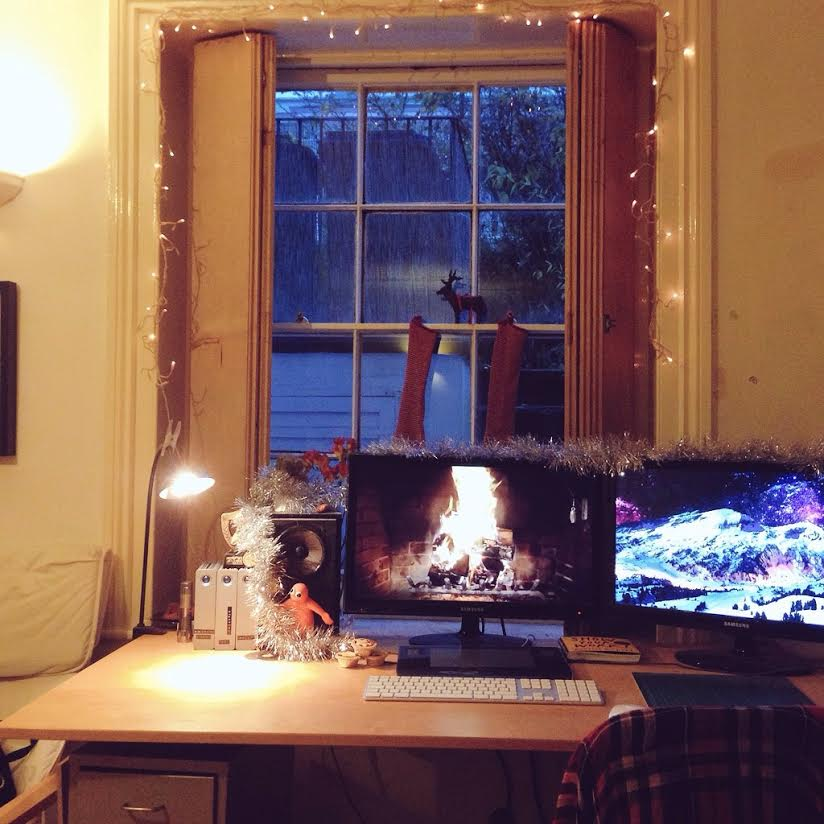 Christmas decorations, complete with a roaring fire.
