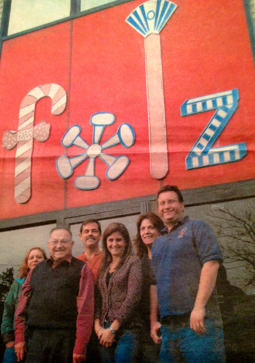 Roger Folz, second from left, and his staff outside his company's headquarters in Oceanside NY. (Credit: Andrew Vardakis)