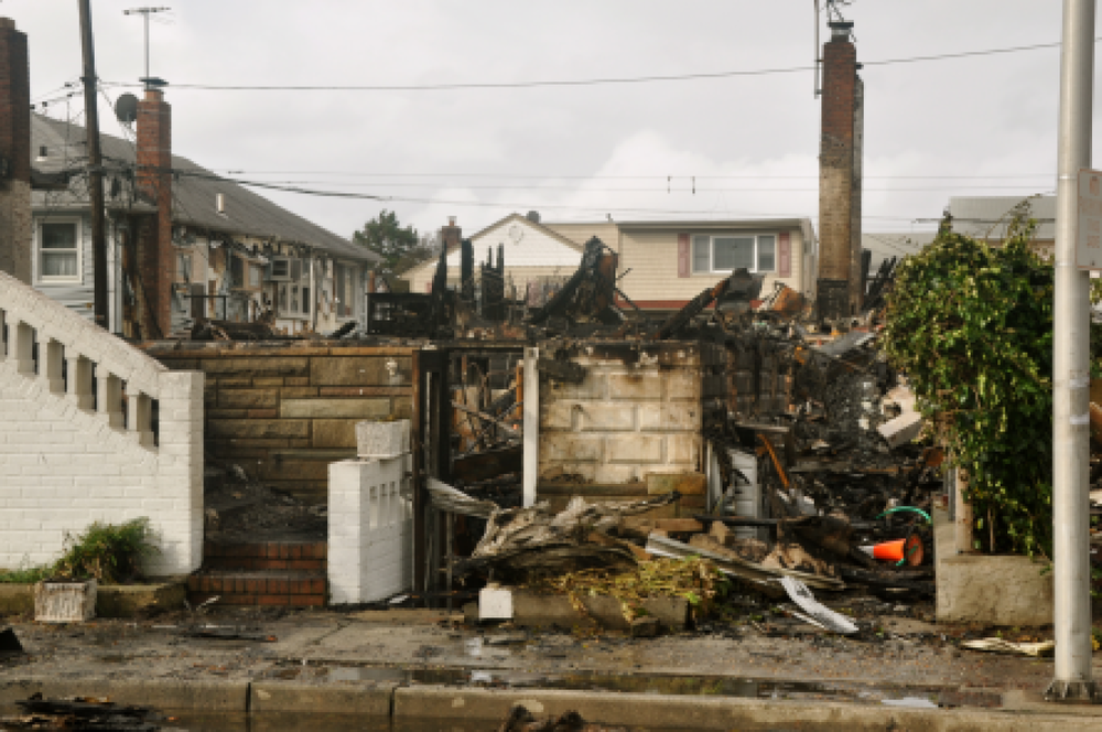 The fire-destroyed homes on Farrell Street the day after the storm. (Photo: Joe Kellard)