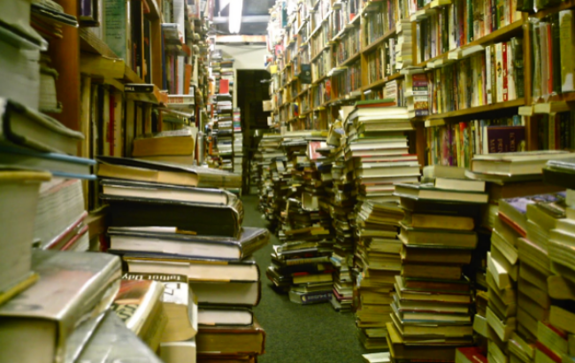 The overburdened shelves and floors at Booklovers Paradise in Bellmore NY. (Photo: Joseph Kellard)