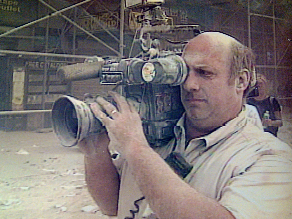 Taken from a Fox special on 9/11, Keith Lane is shown filming the streets of lower Manhattan after the World Trade Center was destroyed. (Courtesy: Dave Corporon/Keith Lane)
