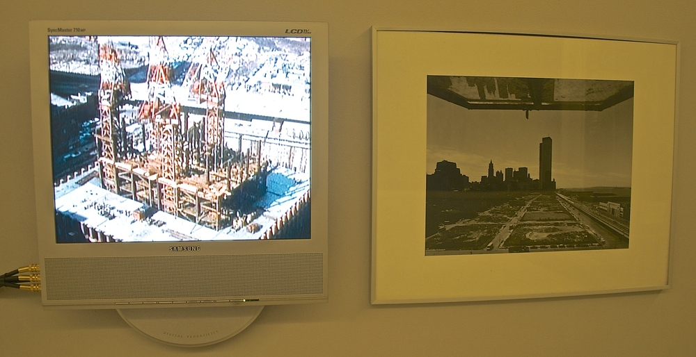 This wall features a video of the World Trade Center construction project (left) and a photo of the towers looking south from a building near the West Side Highway. (Photo: Joseph Kellard/Courtesy Skyscraper Museum).