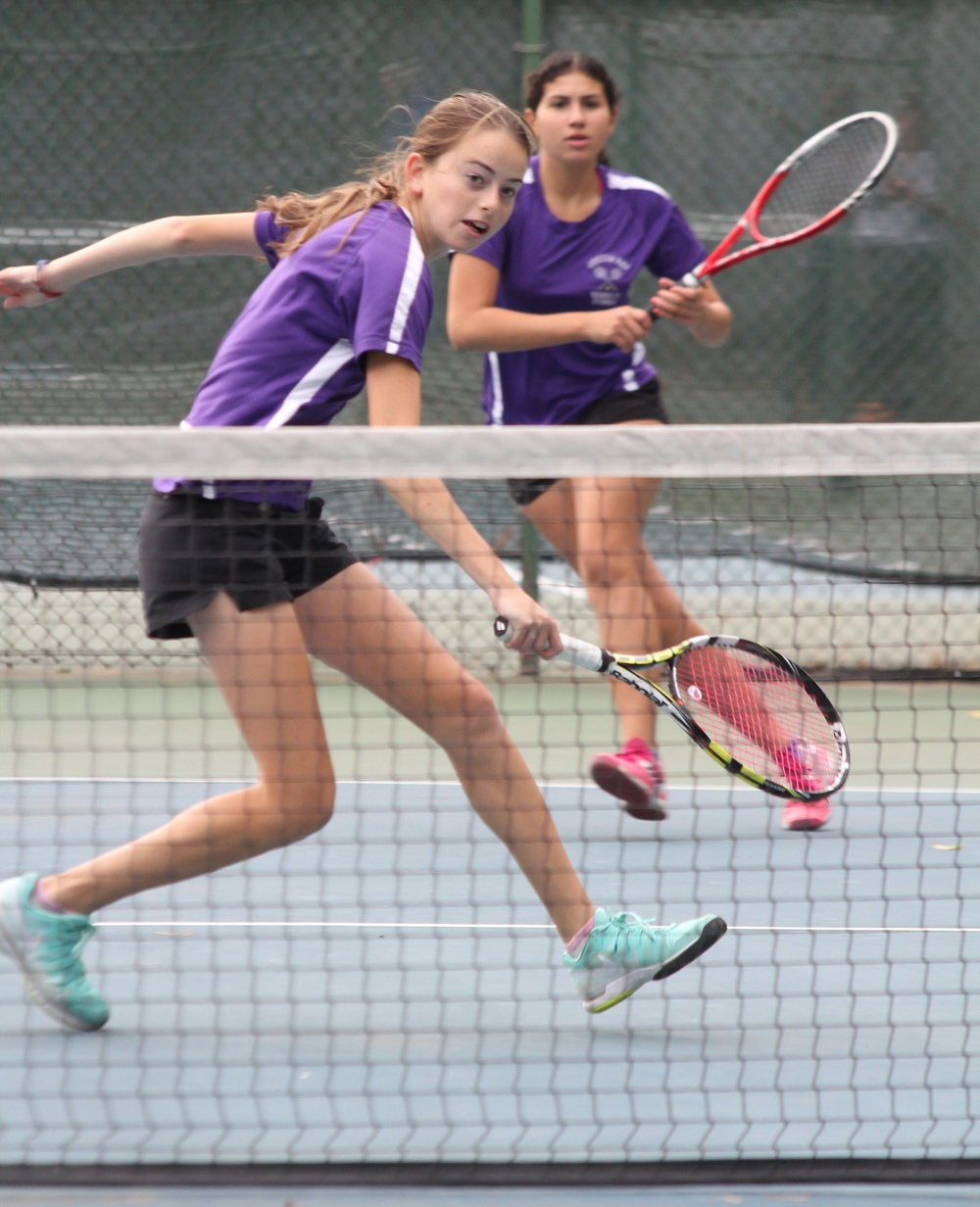 Despite the nerves brought on by the large crowd, television cameras and color commentators, Celeste Matute and Courtney Kowalsky of Oyster Bay High School were able to outshine a top-seeded team and win the 2014 New York State Doubles Tennis Championship in Latham, N.Y. on Nov. 3. READ MORE  (Photo: Keith Kowalsky)