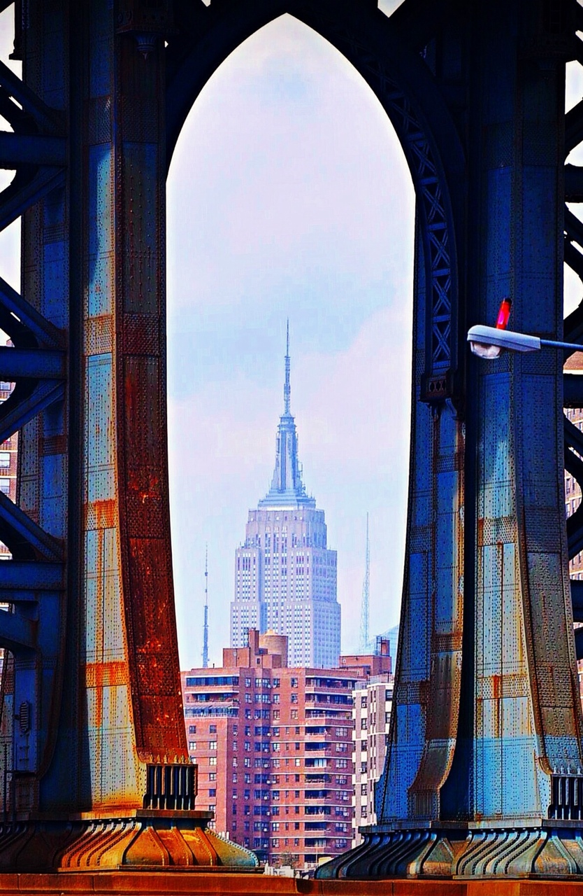 OF RIVETS AND RUST:  Many a photographer has captured this view: the base of the Manhattan Bridge framing the Empire State Building. I wanted to see if I could captured it through a perspective I hadn't yet seen. I think I succeeded, especially in the clarity of the rivets and rust.